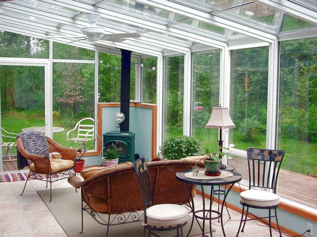 agreeable-sunroom-decorating-ideas-architecture-others-green-fireplaces-black-coffee-table-and-chair-also-rattan-chairs-in-nice-interior-architecture-designs-inspiration